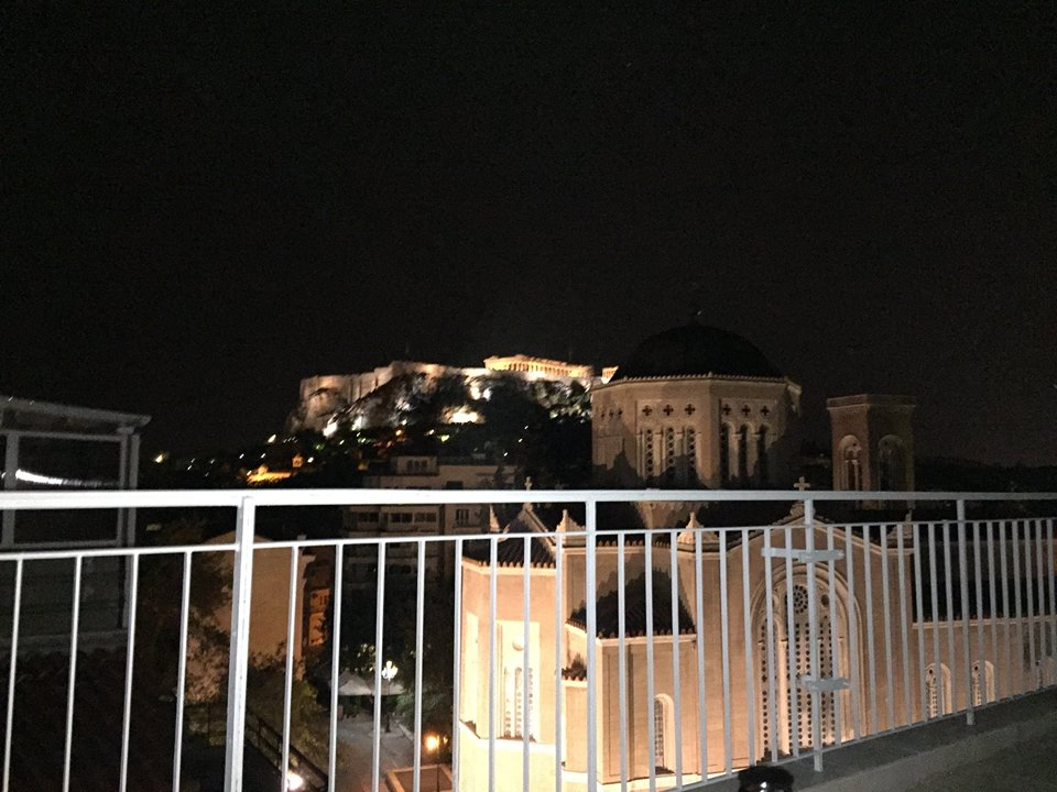A view of the Greek Acropolis in Athens from a balcony a night