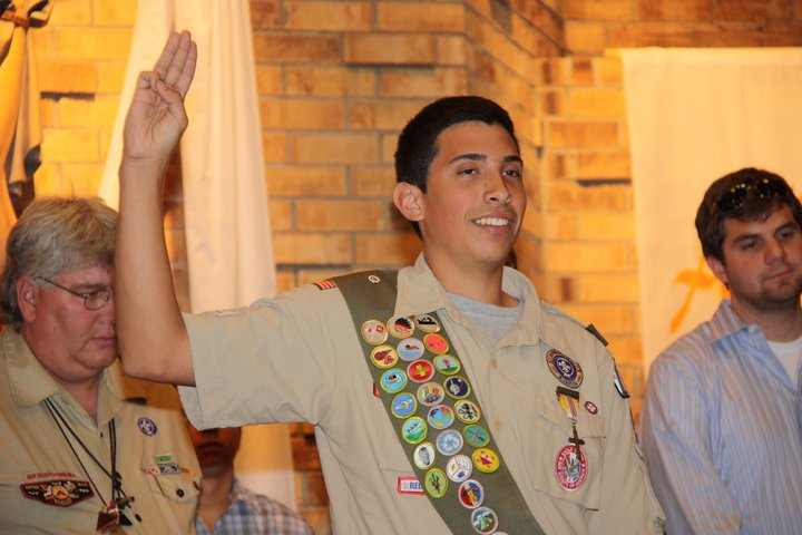 an eagle scout proudly displays his badges
