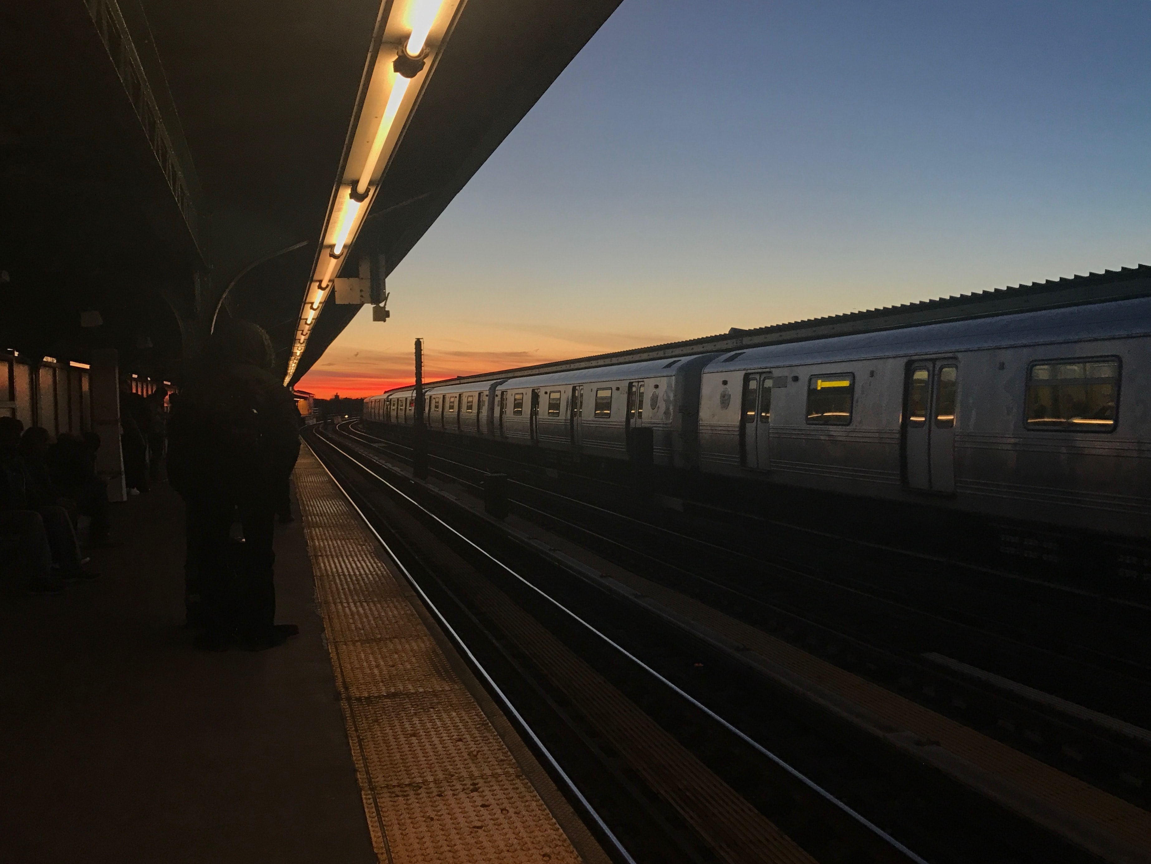 Sunset at Train at subway station in New York City